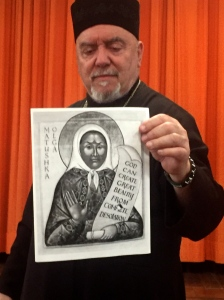 Archpriest Michael Oleksa displaying an icon of Mother Olga