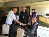 Parish Presiden Mark Curran greeting Fr. Steven's father (also named Steven), who is 100 years old!